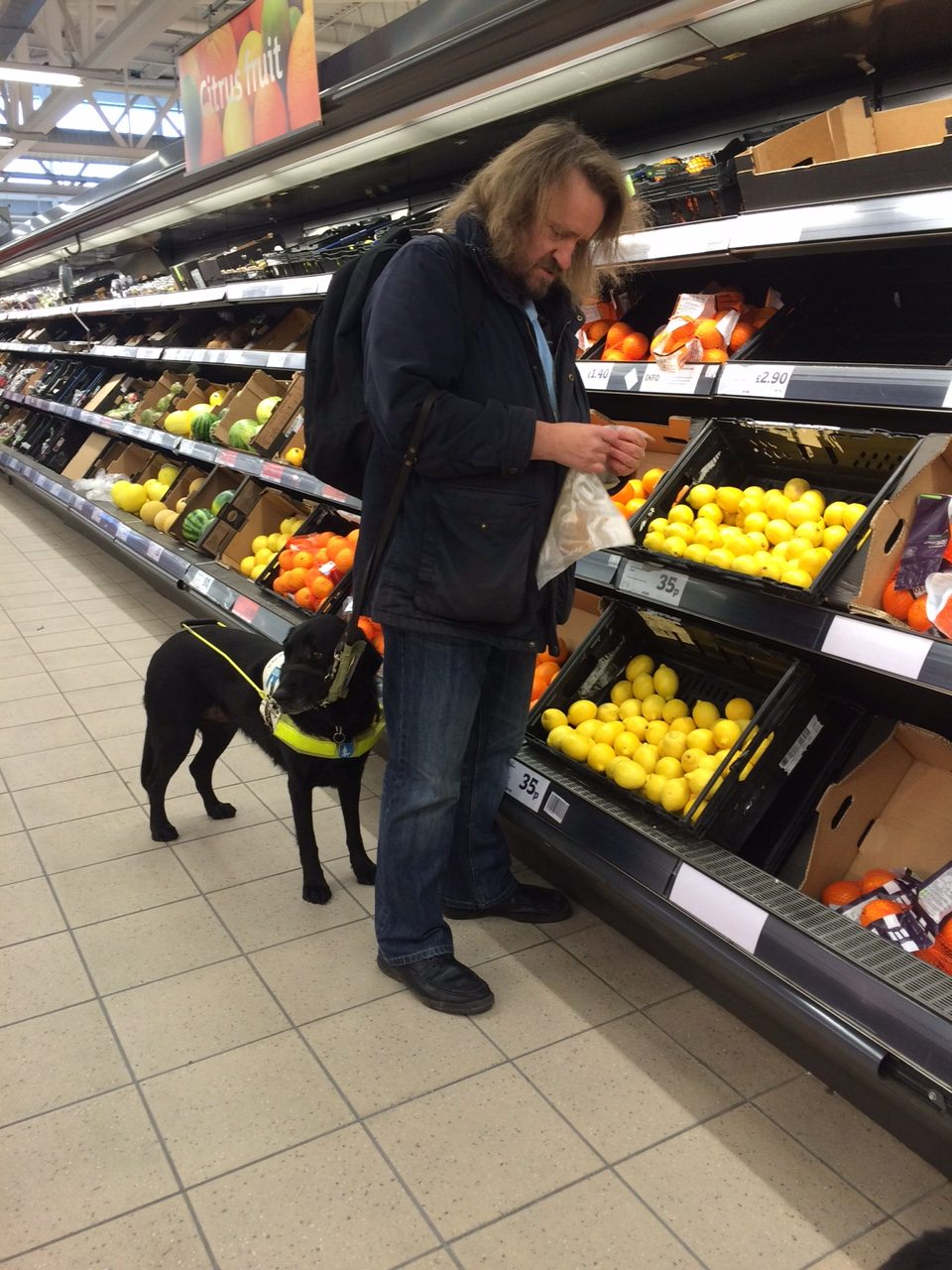 Image of Steve shopping with guide dog